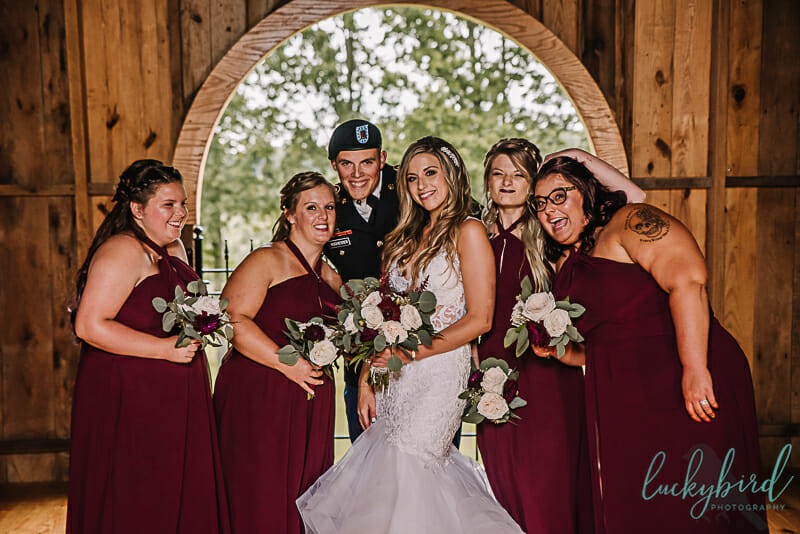 fun photo of bride and her wedding party at the stables whitehouse ohio