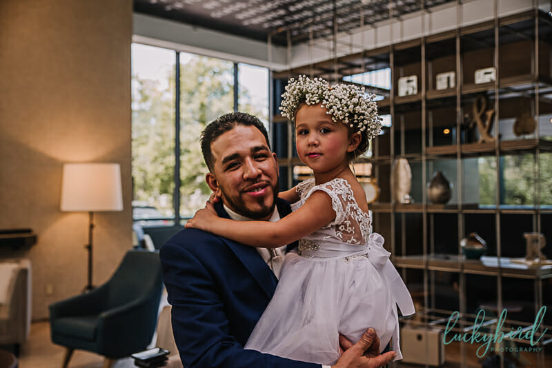 groom and his daughter first look