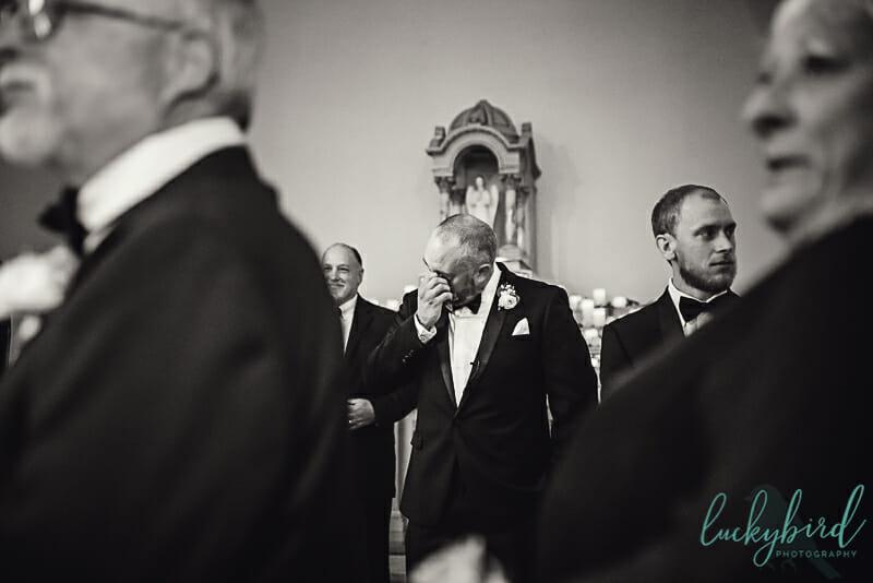 groom crying seeing bride at nazareth hall chapel