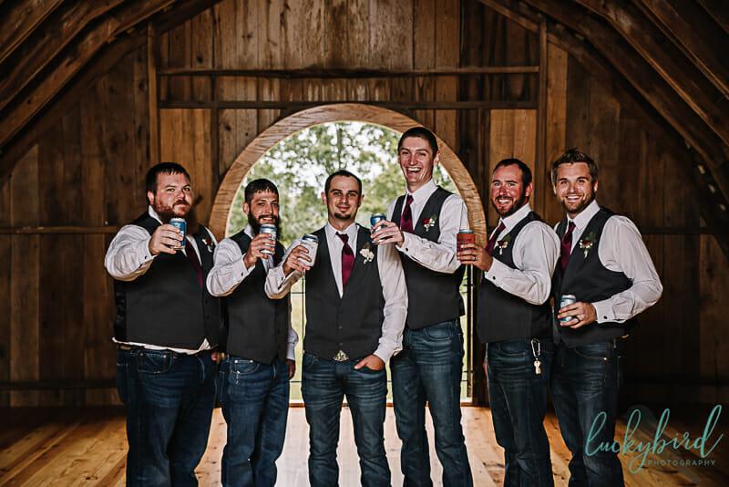 groomsmen wearing jeans rustic stables wedding