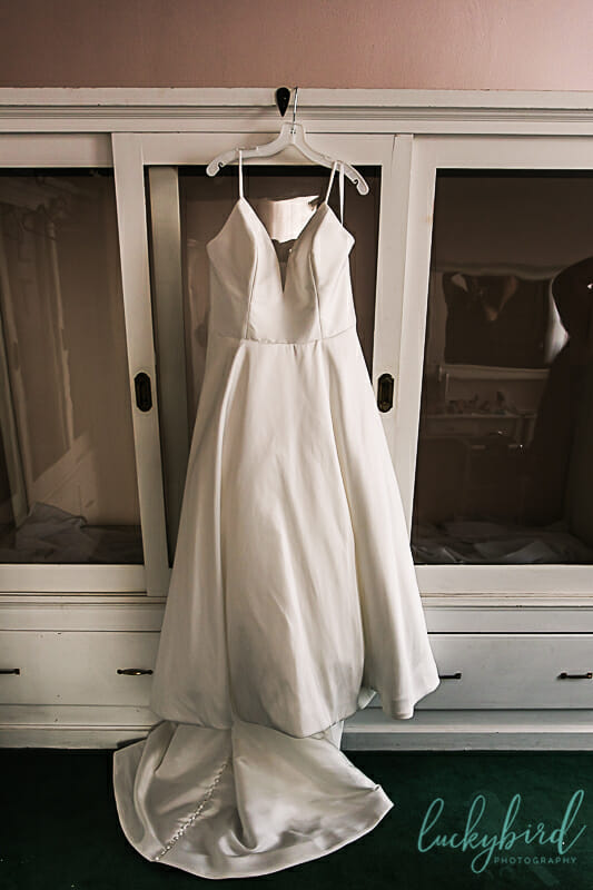 wedding dress hanging in nazareth hall bridal suite