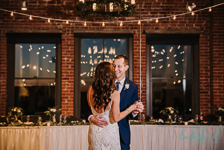 bride and groom first dance at fleetwoods downtown toledo