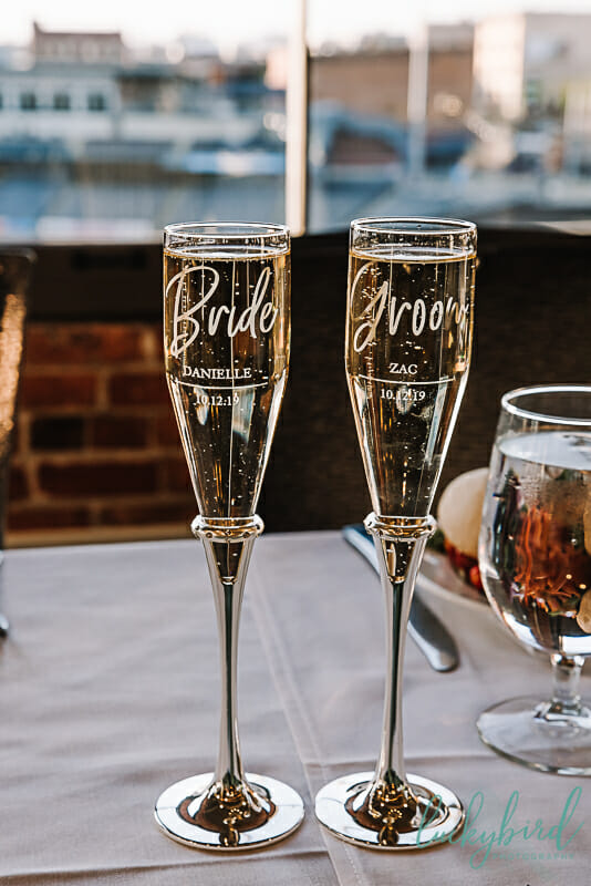 bride and groom toasting glasses in downtown toledo wedding