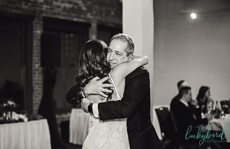 brides dad hugging her during father daughter dance toledo wedding