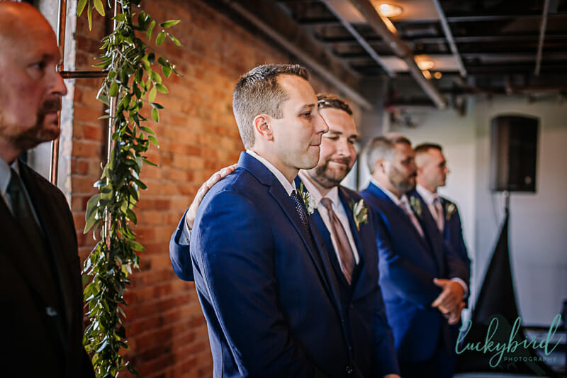 groom seeing his bride walk down the aisle at hensville wedding indoors