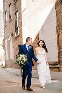 hensville wedding photo walking with groom holding bouquet