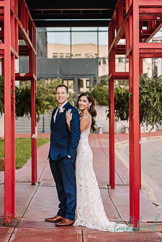 park inn wedding photo outdoors with red arches