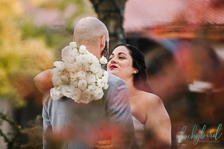 bride and groom first look at toledo zoo fall wedding