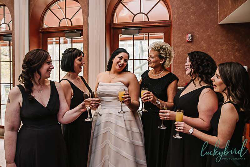 bride and her bridesmaids champagne toast at toledo zoo