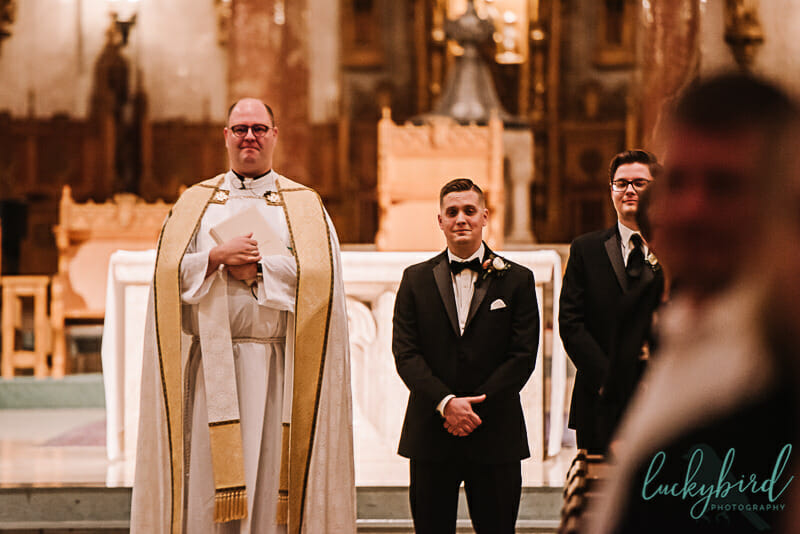 groom seeing bride walk down the aisle at holy rosary wedding