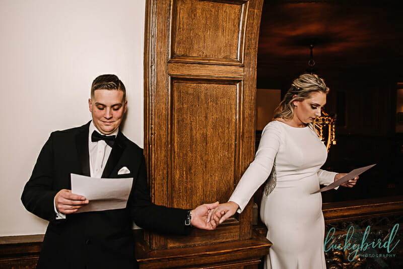 holding hands at toledo club wedding reading notes