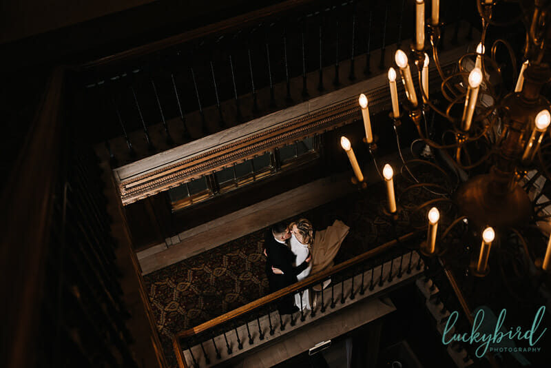 wedding portraits at toledo club wedding with chandelier