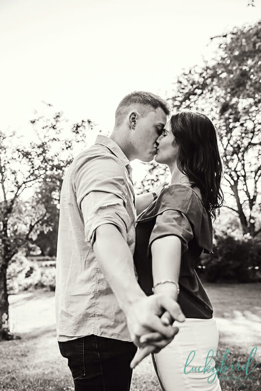 cute engagement photos at the park of roses columbus