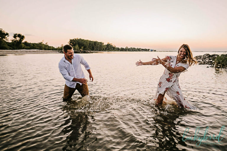 maumee-bay-engagement-photos-in-the-water-splashing-1620x1080