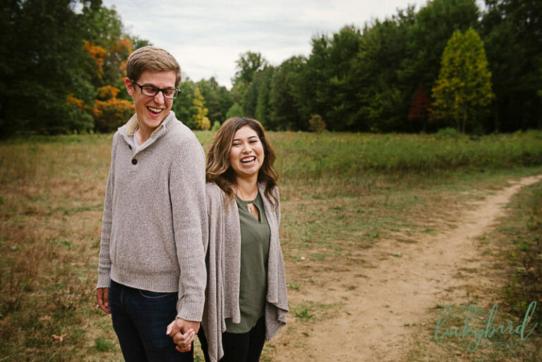 fall wildwood engagement photos in field