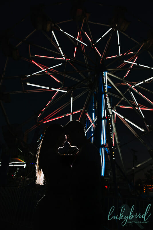 wood county fair engagement photos with ferris wheel
