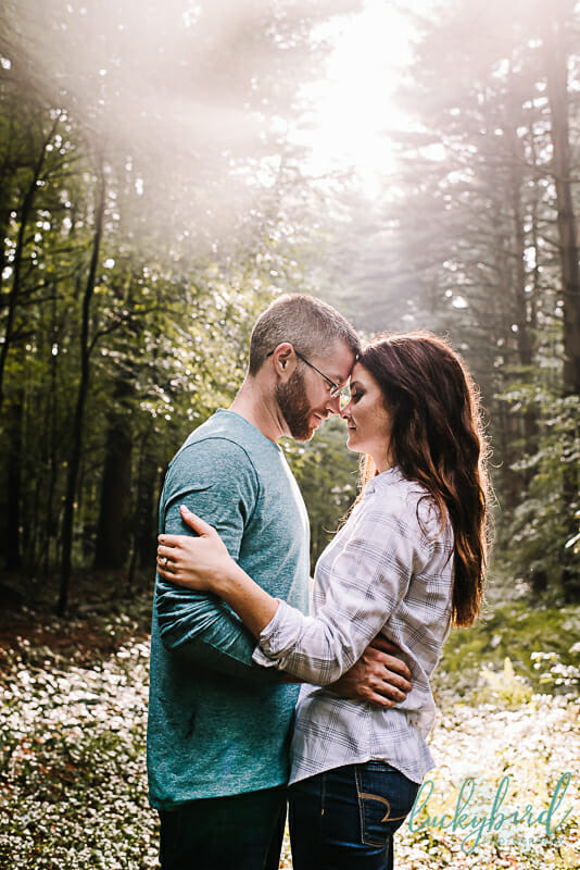 the spot oak openings engagement photos with tall trees