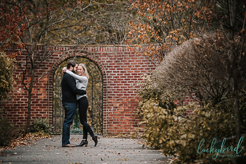 engagement session with fun loving couple in toledo park