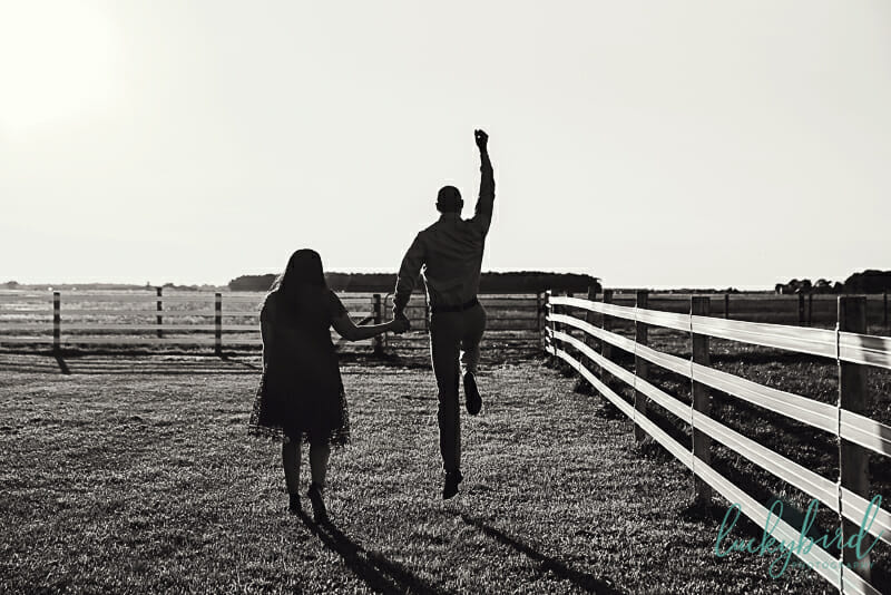 groom jumping during engagement session in perrysburg