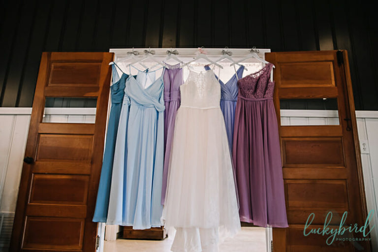 bridesmaids dresses hanging wine room stables