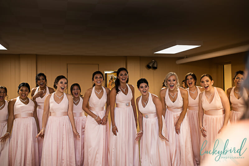 bridesmaids first look with bride on wedding day