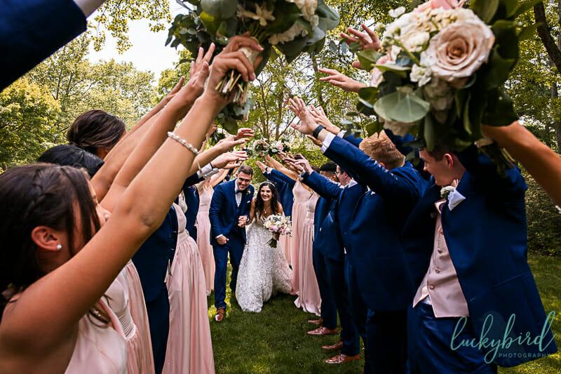 fun wedding party photo at toledo botanical garden