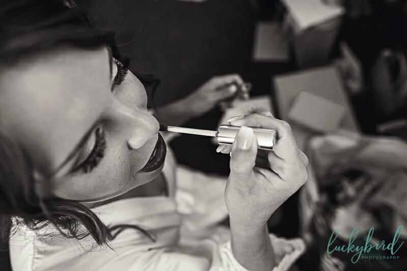 bride getting her makeup on at nazareth hall