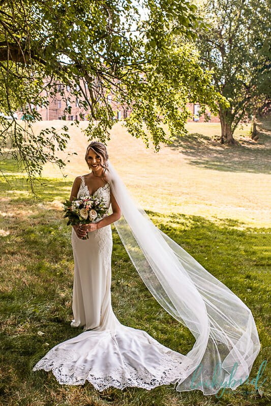 bride with cathedral length long veil at nazareth hall