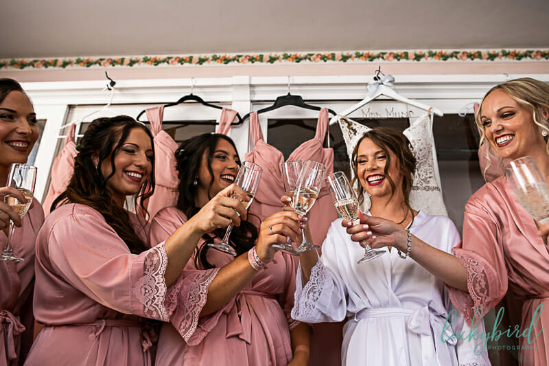 bridesmaids saying cheers with champagne at nazareth hall