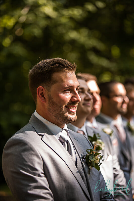 groom seeing bride walk down the aisle at grotto nazareth hall wedding ceremony