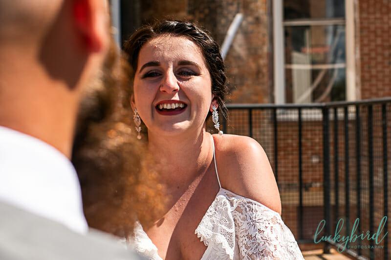 bride seeing groom downtown toledo first look