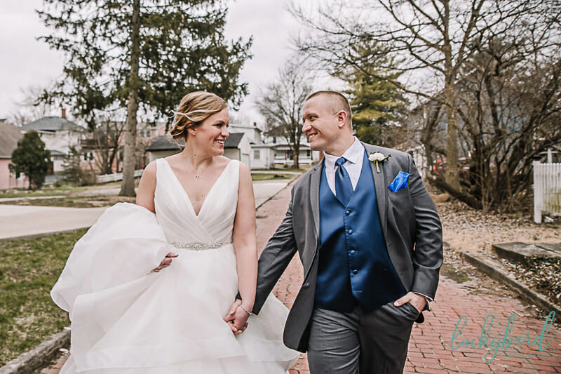 couple walking during wedding photos in columbus ohio alley