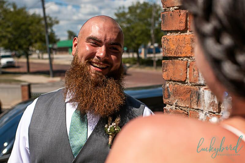 groom seeing bride downtown toledo first look