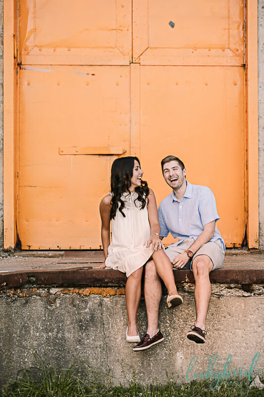 engagement photos in toledo with fun wall