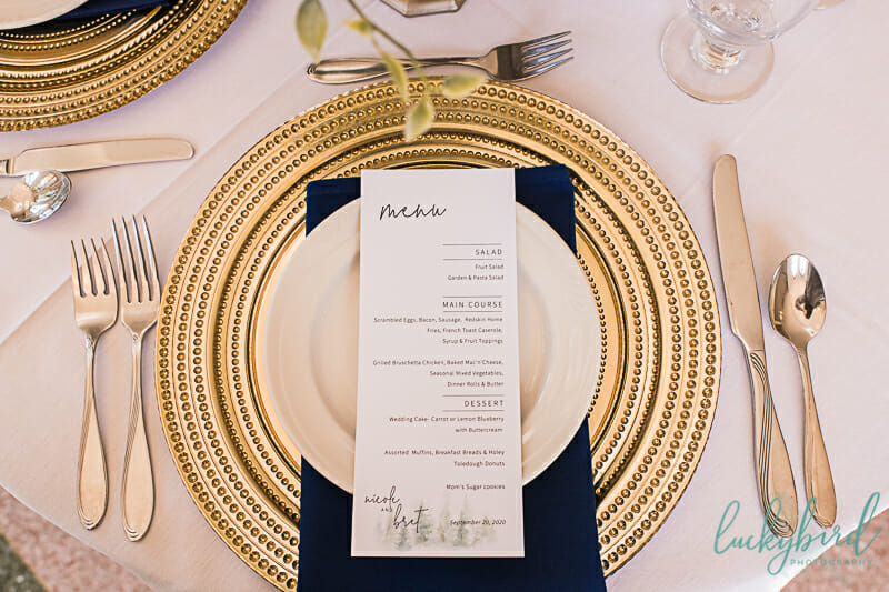 gold and navy wedding charger and decor nazareth hall