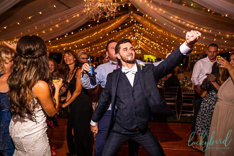 groom dancing during perrysburg wedding