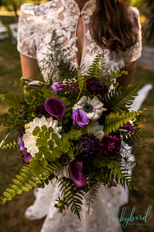hafner florist toledo bouquet with purple green and white
