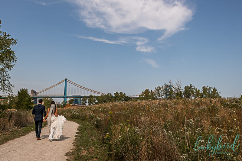 middlegrounds park wedding photo with bridge in background