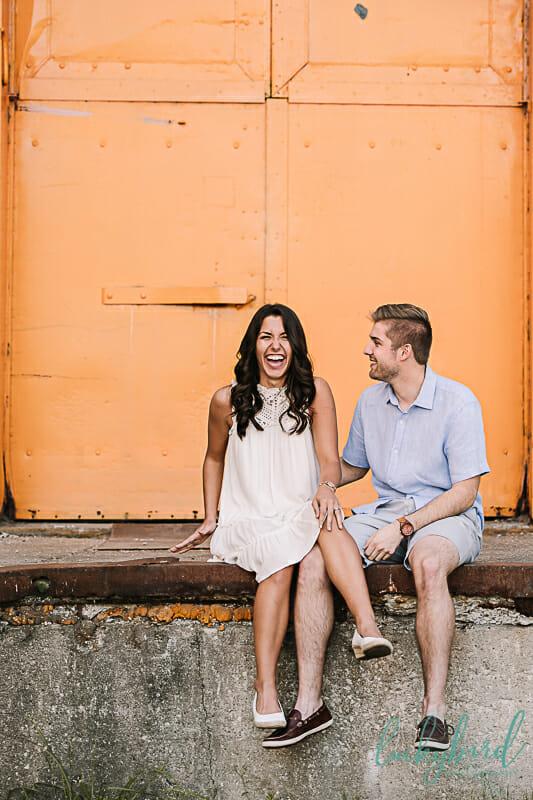 toledo engagement photos with orange backdrop
