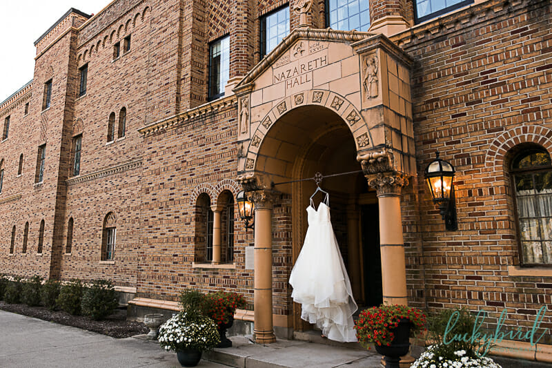 wedding dress hanging out front at nazareth hall