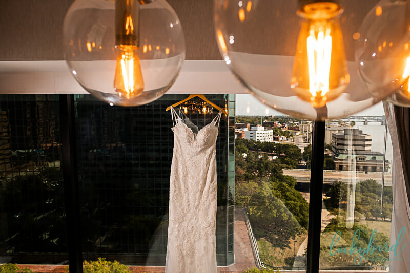 wedding gown hanging at renaissance toledo hotel