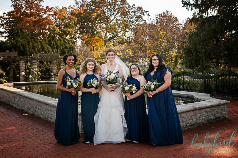 bride and bridesmaids in front of conservatory toledo zoo