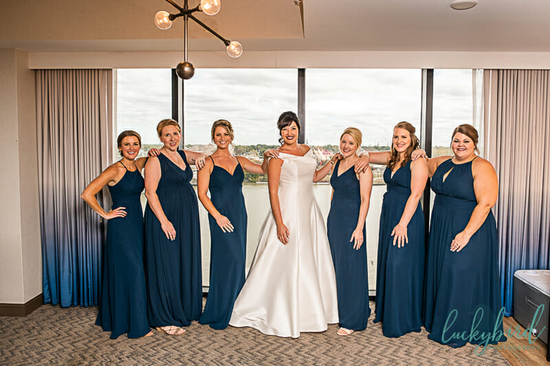 bride and bridesmaids in navy dresses at renaissance hotel