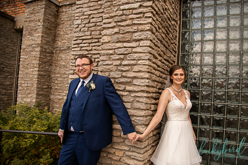 bride and groom first touch at toledo zoo wedding