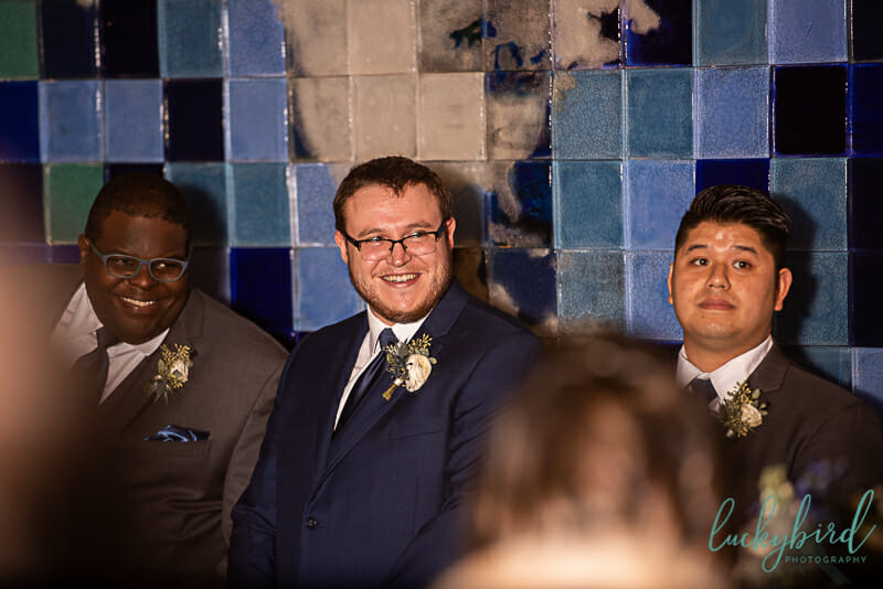 groom seeing bride at toledo zoo wedding