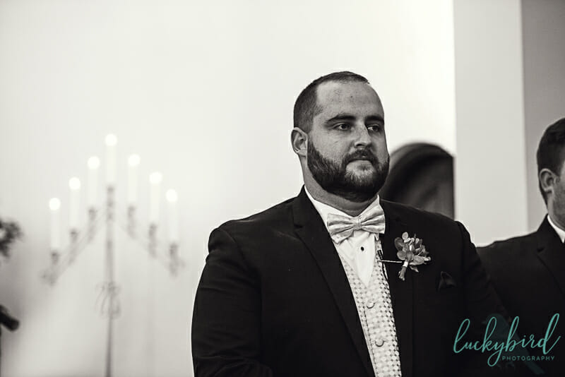 groom seeing bride walk down the aisle at the chapelgroom seeing bride walk down the aisle at the chapel