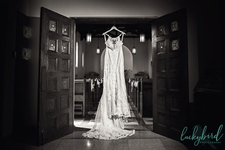 wedding dress hanging at nazareth hall chapel