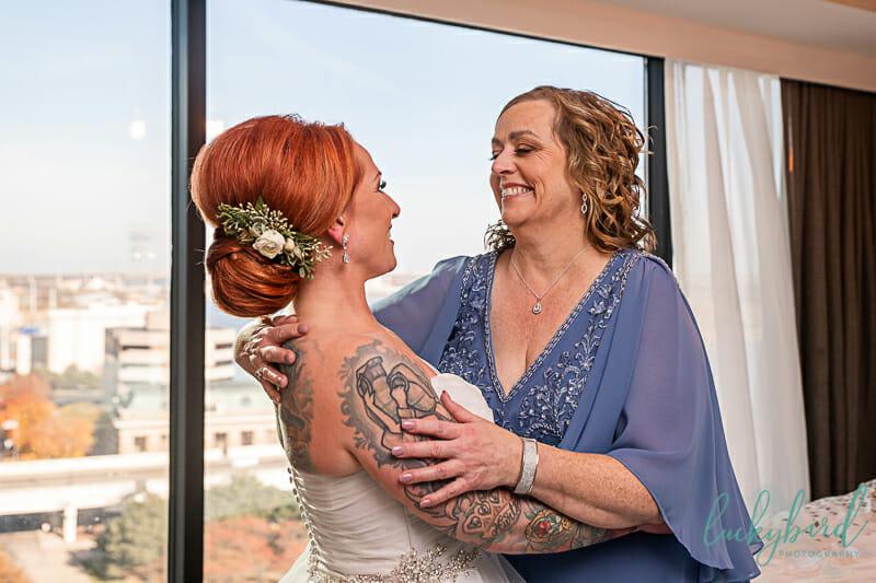 bride and mom sharing a hug at renaissance toledo