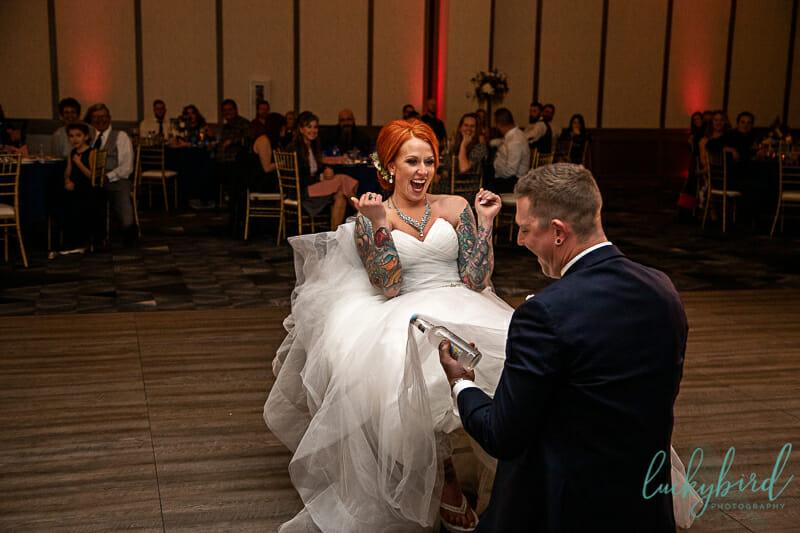 bride icing groom during garter removal renaissance toledo
