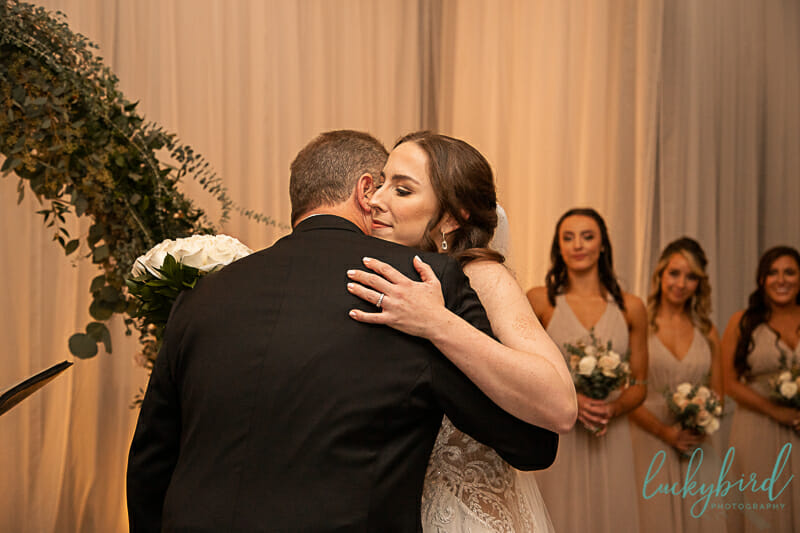 bride and brother dance at renaissance toledo wedding